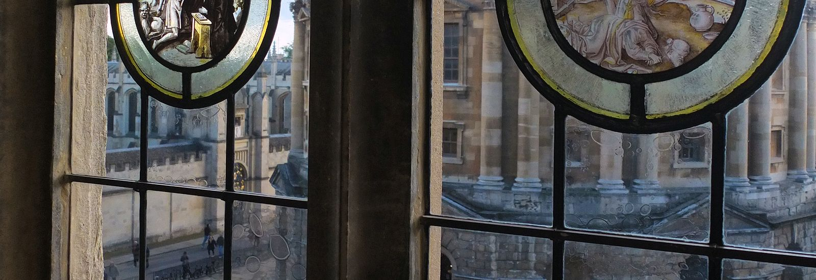 Close up of stain glass windows looking out over Radcliffe Square