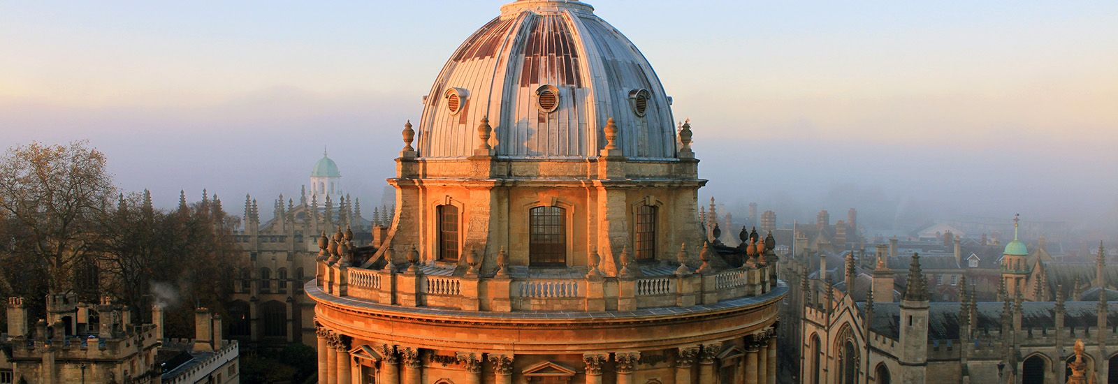 The dome of the Radcliffe Camera and spires of Oxford on a misty morning
