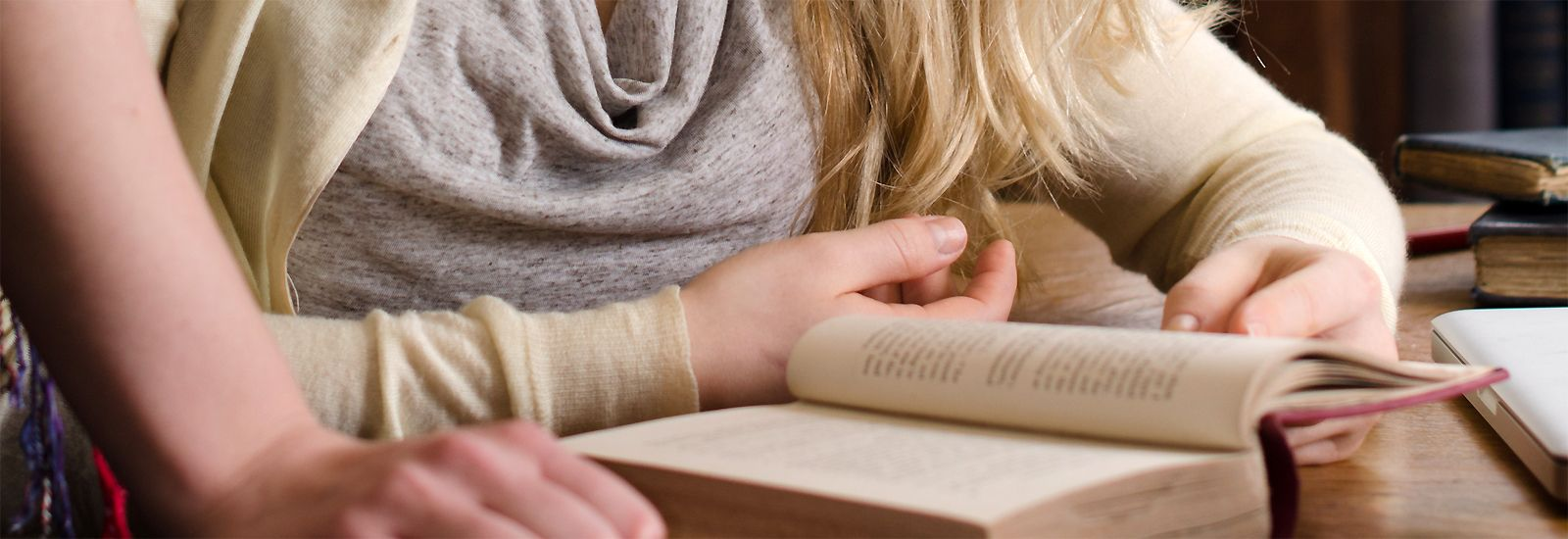 Close up of a student with an open book