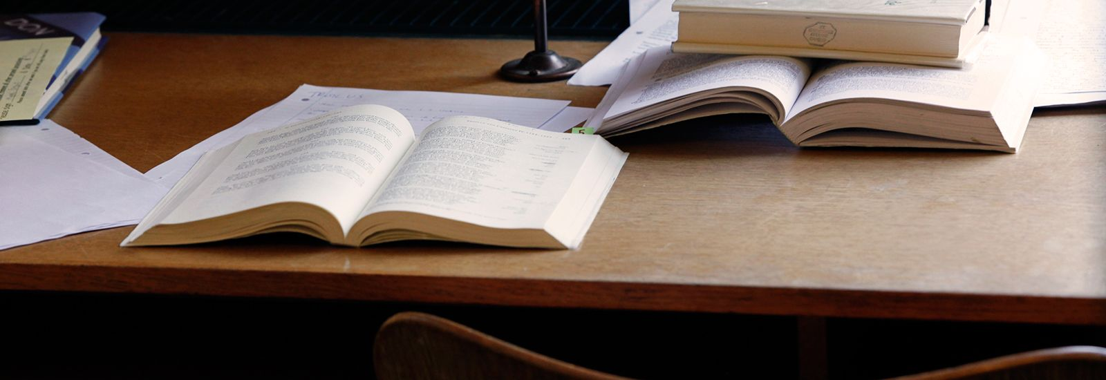 Open books on a wooden desk