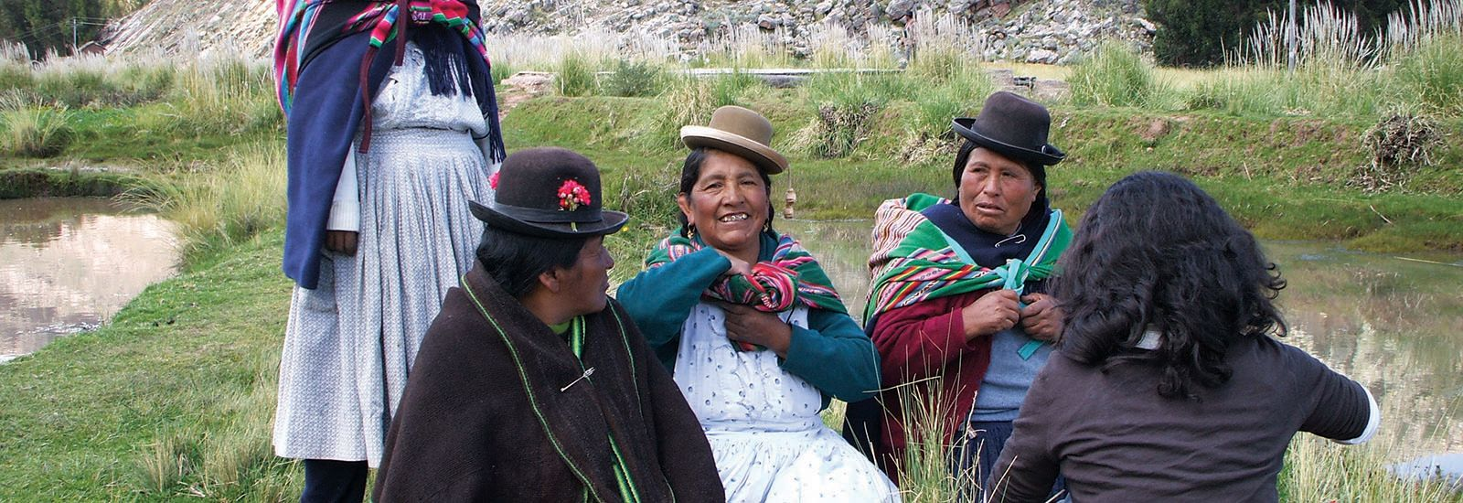 5 people with four in traditional Peruvian clothing