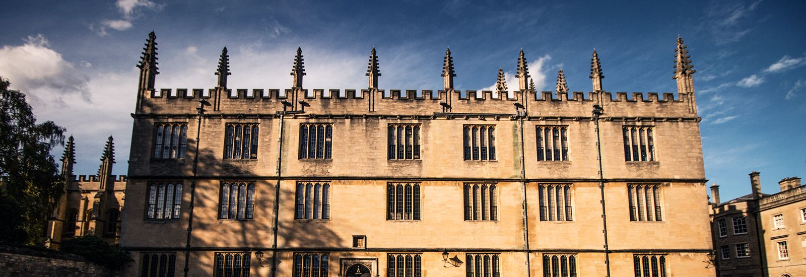 The side of the Bodleian Library against a blue sky