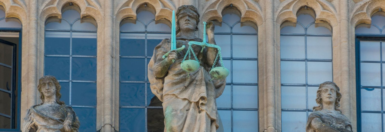 Detail of the façade of the Bodleian Library in Oxford showing Justice with her scales and blindfold