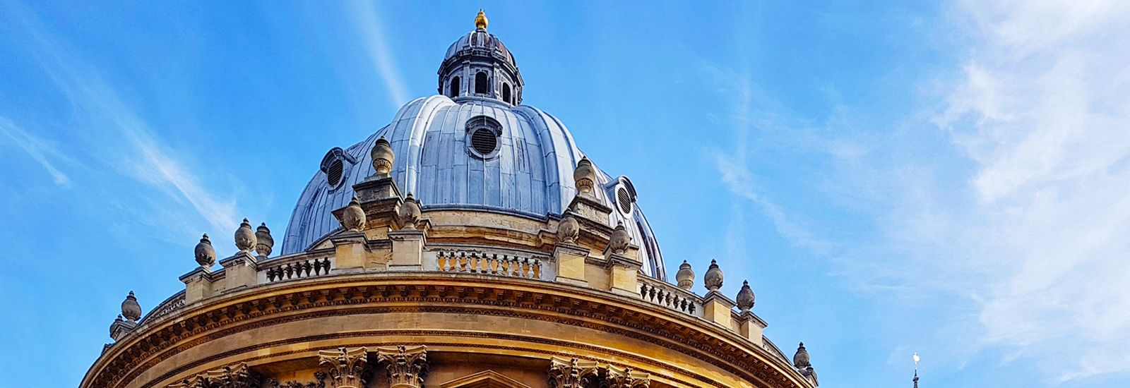 Top of the Radcliffe Camera's dome against a blue sky