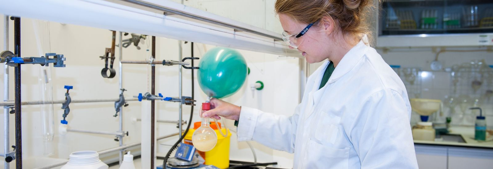 A student performs an experiment in a Chemistry lab