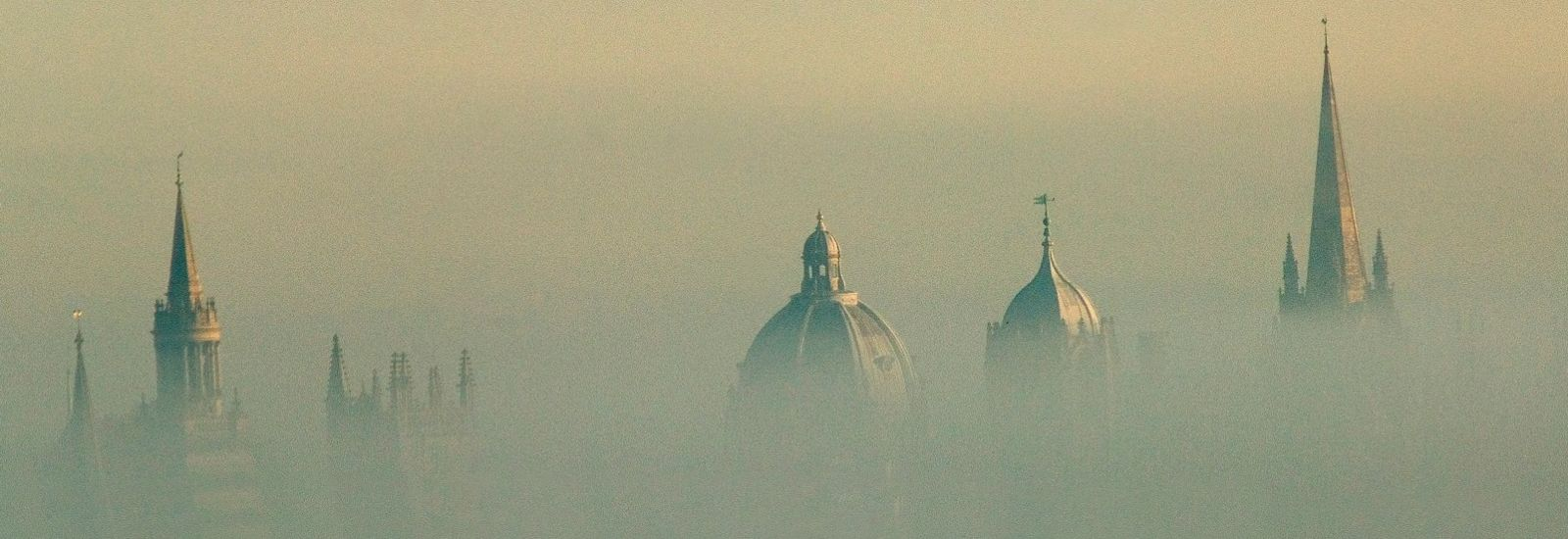 Early morning mist over the rooftops of iconic Oxford