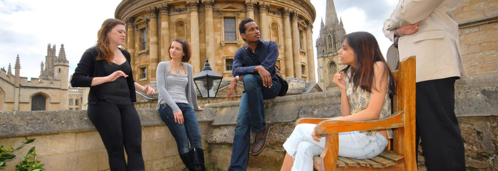 Group of graduate students chatting in Exeter College Fellows' Garden, Oxford, UK