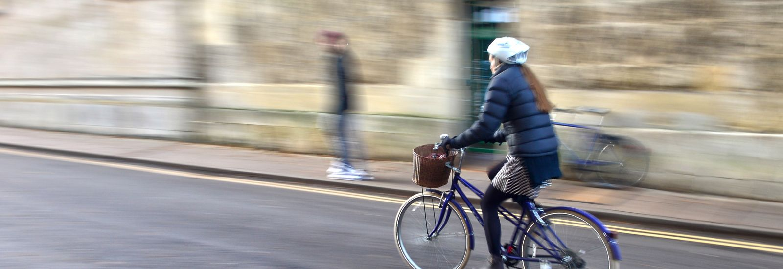 University student cycling across Oxford