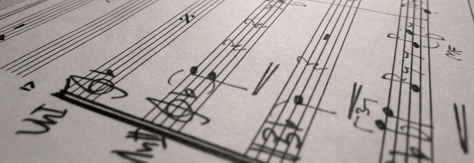 A close up of handwritten sheet music