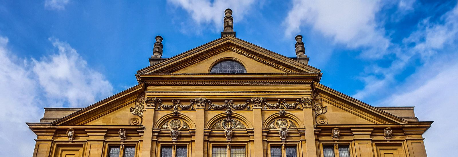 The back and spires of the Sheldonian against a blue sky