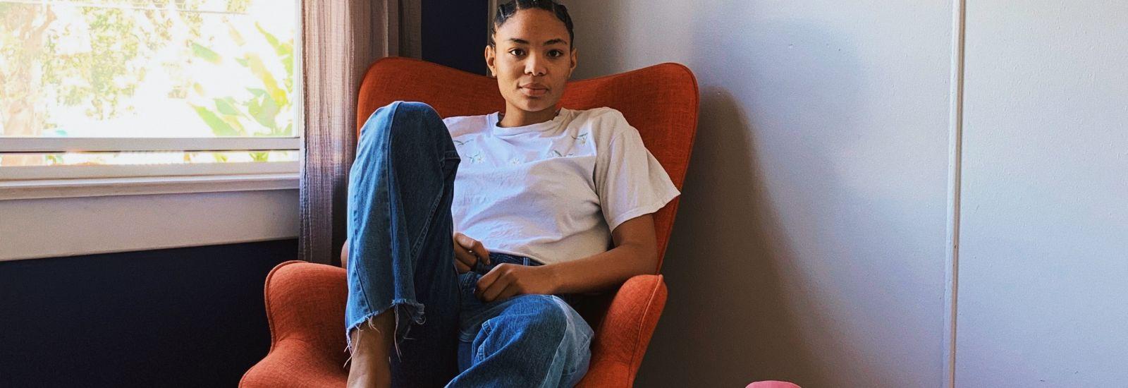 person sitting on chair. Credits: Monique Rangell-Onwuegbuzia via Unsplash