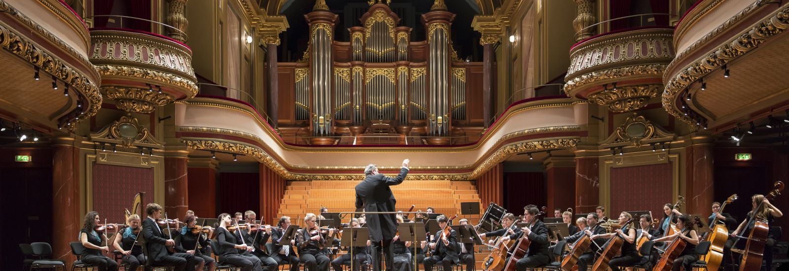 GENEVA - NOVEMBER 30: Antoine Marguier conducts the United Nations Orchestra rehearsal at the Victoria Hall November 30, 2013 in Geneva, Switzerland. The concert supports PVA-Geneva work in Cameroon.