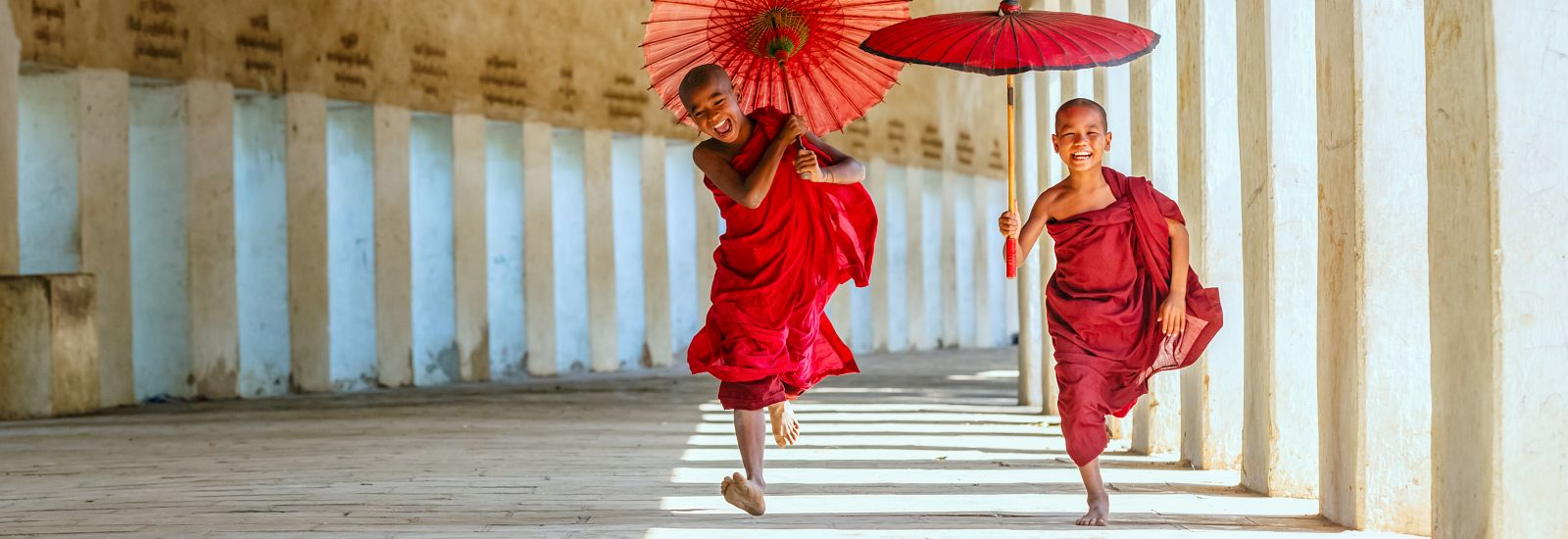 BAGAN, MYANMAR - DEC 6: Unidentified young Buddhism novices at Shwezigon temple on Dec 6, 2014 in Bagan. Buddhism is predominantly of the Theravada tradition, practised by 89% of the population.