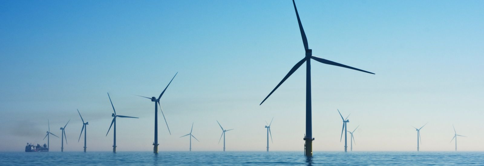 Off-shore wind farm with blue sky