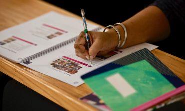 Teacher writing notes