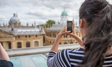 Student taking image of Oxford with mobile