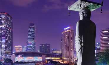 Statue at the Bongeunsa Temple against the Seoul skyline