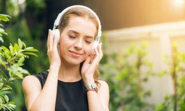 Generic image of a woman enjoying music through headphones