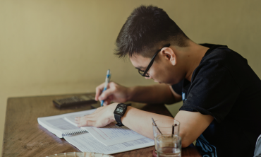 Man studying at desk.