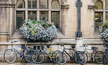 Bicycles against a wall in Oxford