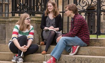 Students sat on the steps of Merton College