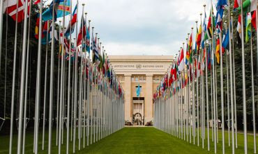The United Nations office at Geneva, viewed through an avenue of flags of all the member states