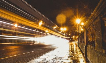 Lights from passing traffic on Magdalen Bridge at night