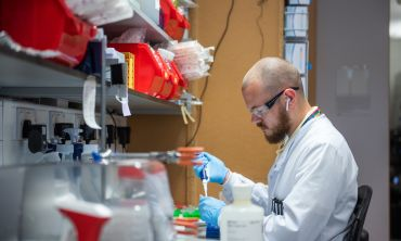 A researcher works on the Oxford coronavirus vaccine