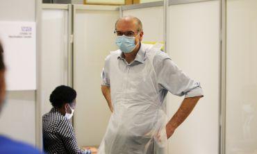 Photo | Prof. Pollard preparing to deliver coronavirus vaccinations at the Kassam Stadium (c) Oxford Health NHS Foundation Trust