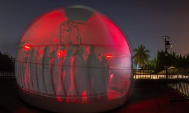 Global Jet Watch in glow of observatory against starry night sky