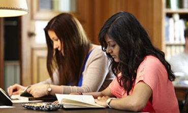 Two students studying in one of Oxford's libraries