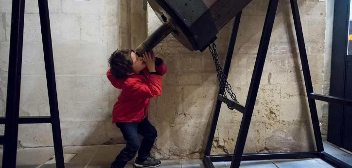 Boy and telescope at the Museum of the History of Science, Oxford.