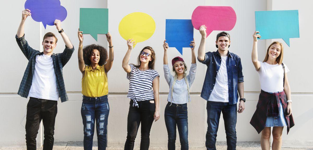 Six students each holding a speech bubble