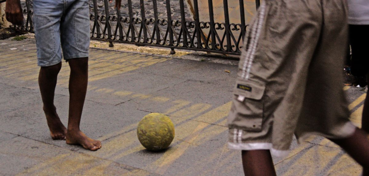 Children in Brazil playing football in the street