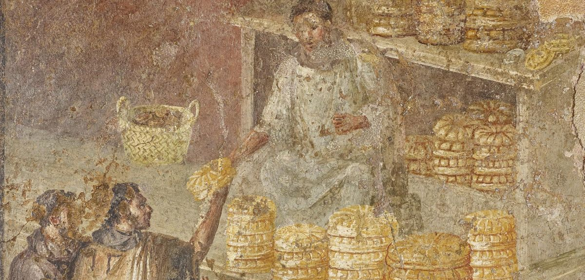 A mural of a baker giving out bread