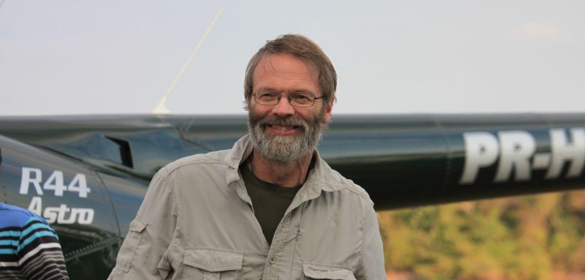 David Macdonald conducting field work in Brazil
