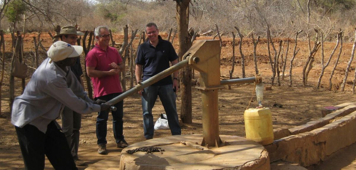 Research trip to Kyuso, Kenya. L to R: Handpump mechanic in Kenya; Patrick Thomson, Oxford; Dr Rob Hope, Oxford; and Dr Peter Harvey, UNICEF.
