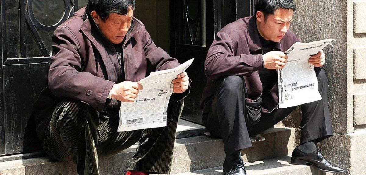 Chinese men reading