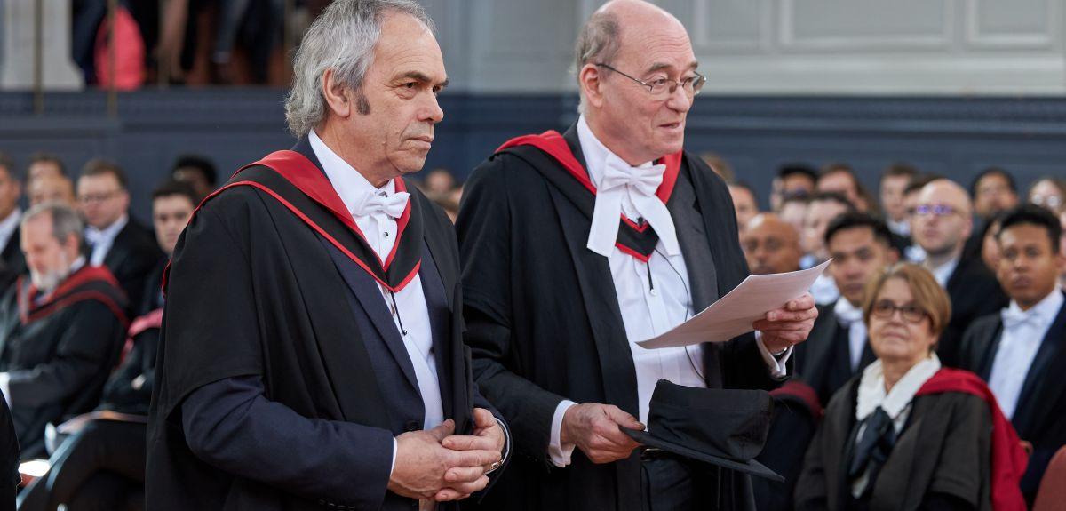 John Harris (left) receives his honorary MA. Image by Ian Wallman