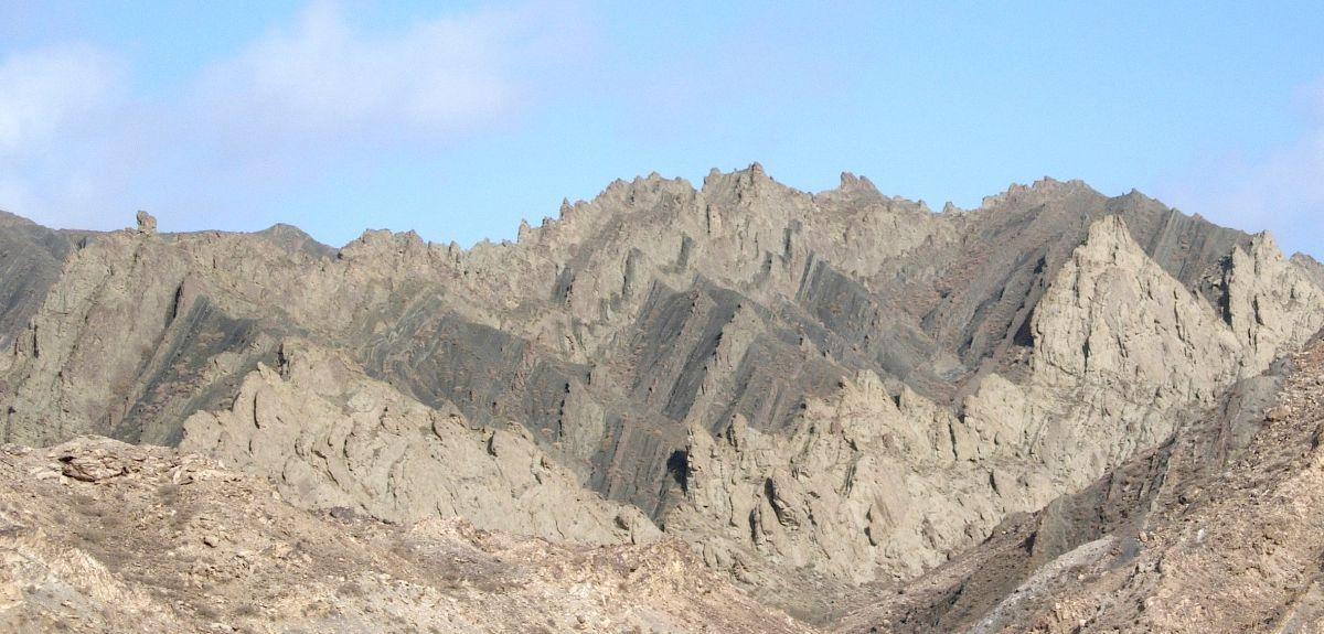 Photo shows Early Jurassic lake sediments (black shales) formed in the Tarim Basin, China