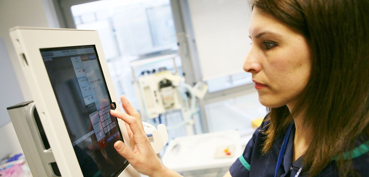 A member of staff at Oxford University Hospitals NHS Foundation Trust using a SEND tablet