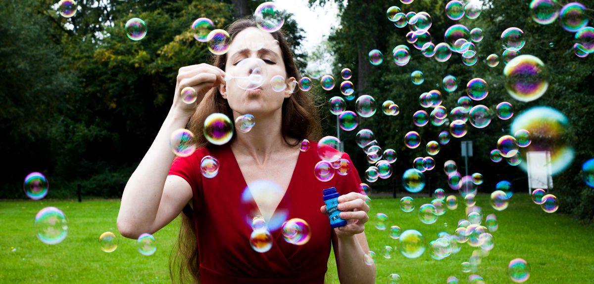 Eleanor Stride blowing soap bubbles