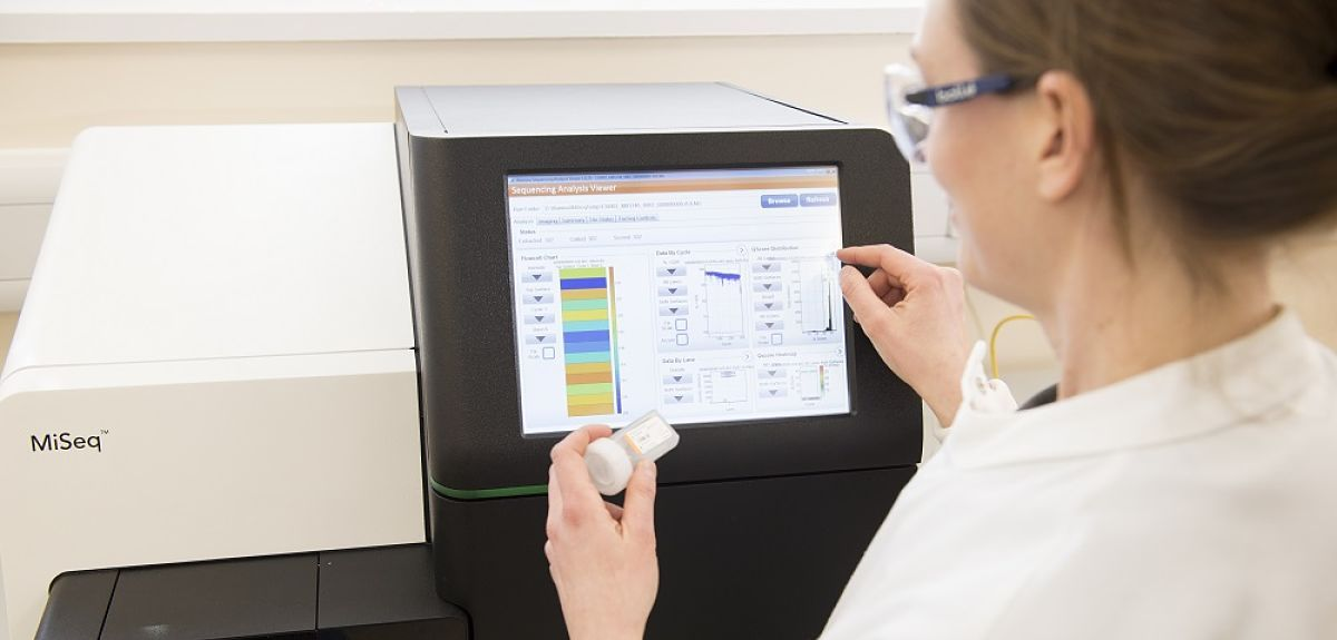Scientist using a genetic sequencer