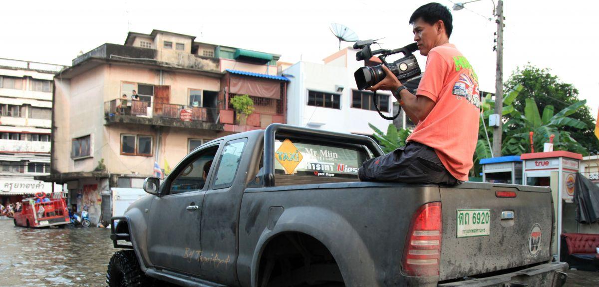 TV crew films flooding in Thailand.