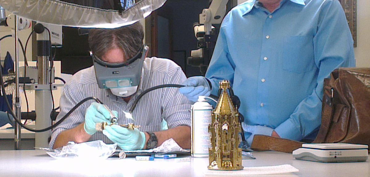 Professor Tom Higham takes a sample from finger bone attributed to St John the Baptist.