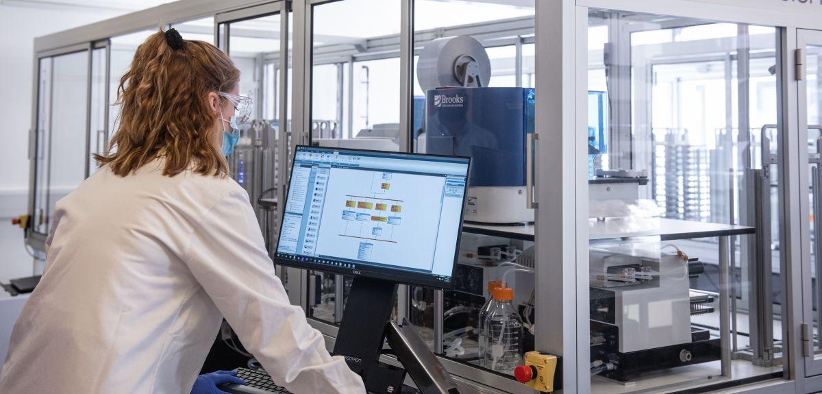 Female scientists using the serology machine