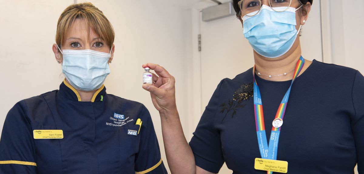 Photo | Nurses Sam Foster and Meghana Pandit display a vial of the Oxford coronavirus vaccine