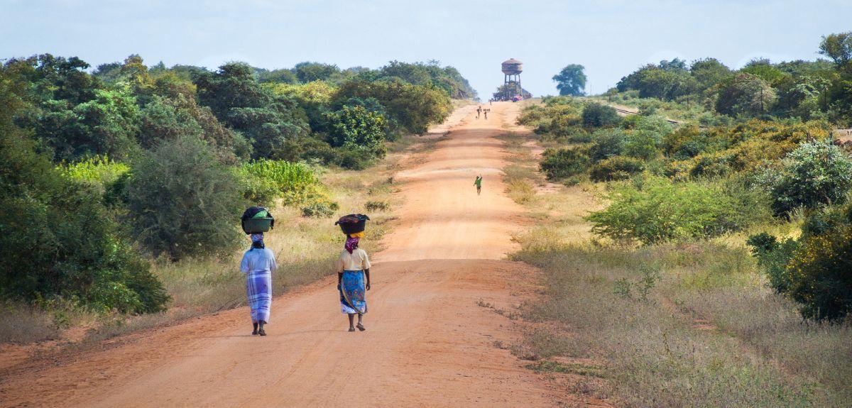African women walking along road