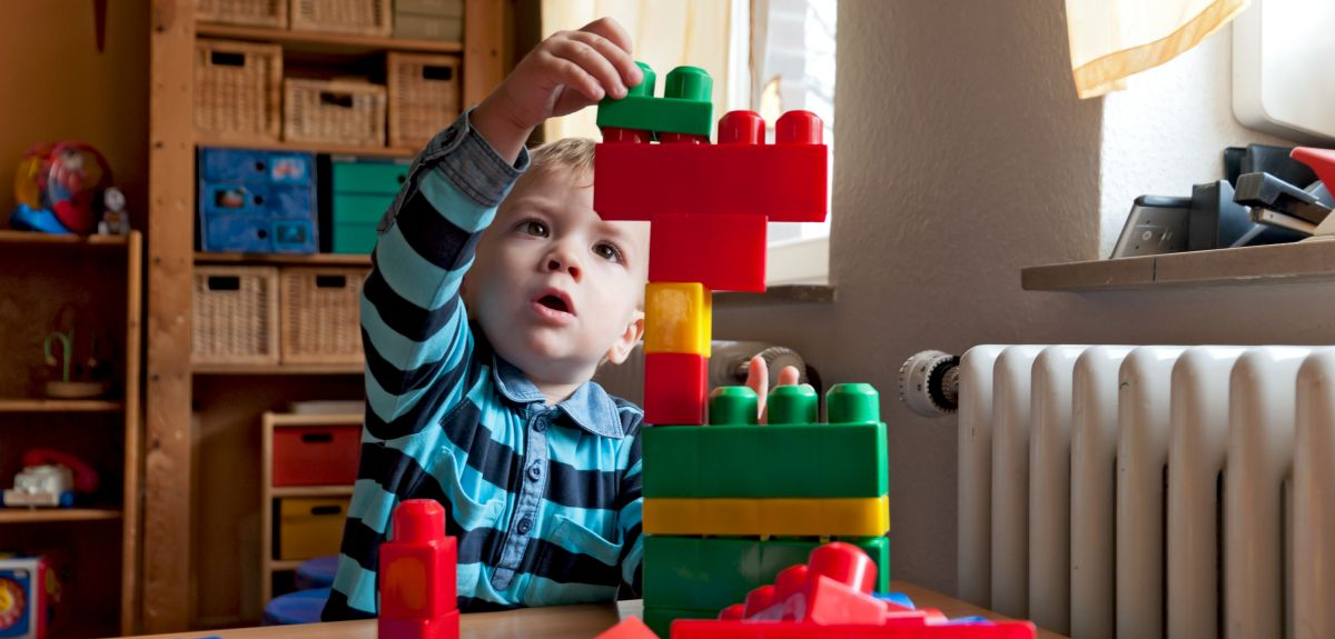 Child plays with building blocks