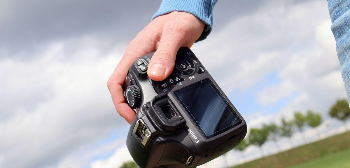 Man holding a Canon camera